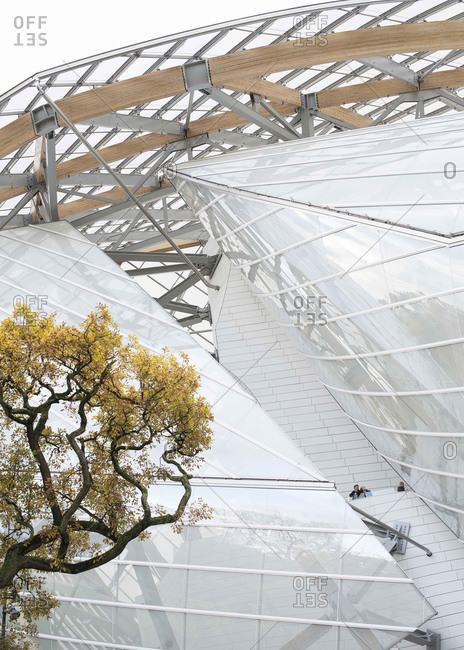 Paris, France - November 15, 2014: Louis Vuitton Foundation Building By architect Frank Gehry and tree