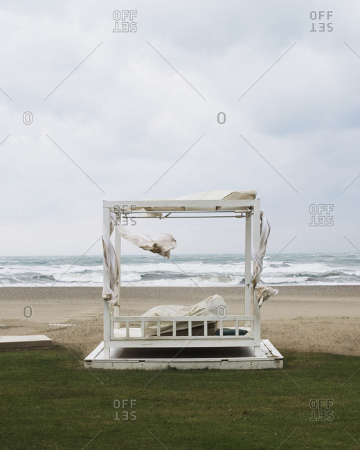 Wooden pergola on a windy beach