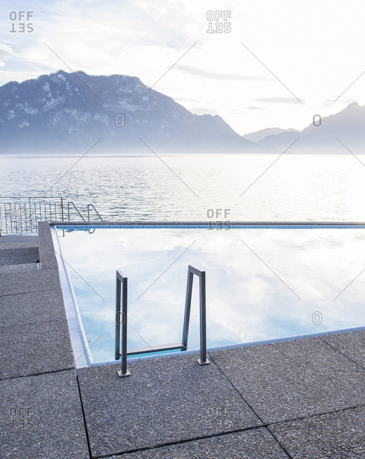 Swimming pool beside a lake and mountains