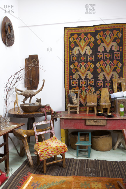 Buenos Aires, Argentina - November 9, 2010: Room with hand carved folk art, furniture and textiles