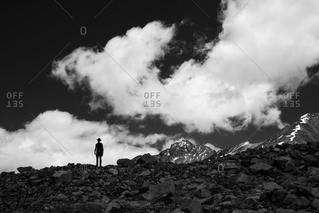 Man standing on a rocky mountain ridge