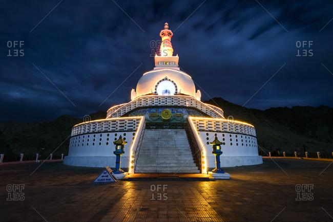 Shanti Stupa illuminated at night in Leh, India