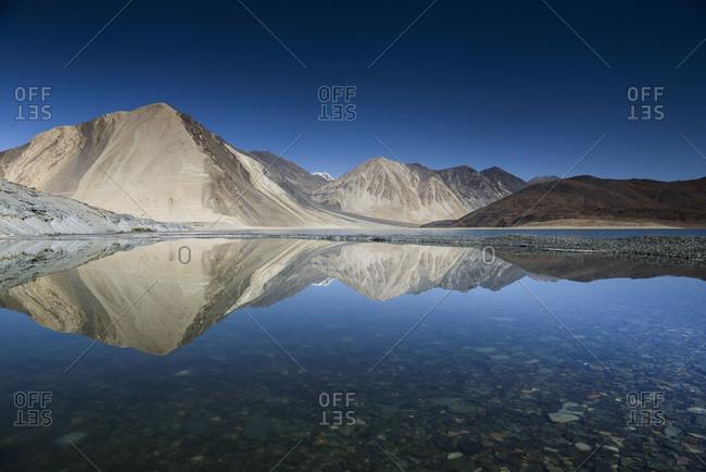 Mountains reflected in Pangong Tso lake