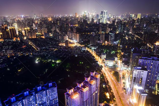 Hong Kong skyscrapers and highway illuminated at night