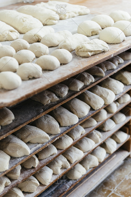 Balls of dough on trays in a bakery in Avignon, France