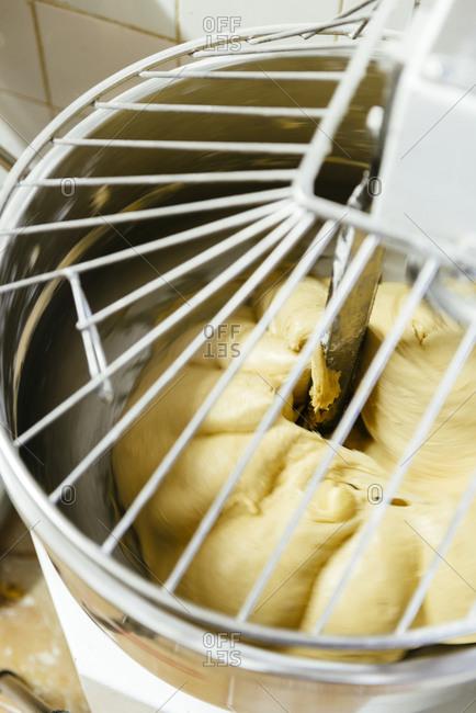 Dough ball in a mixer in a bakery in Avignon, France