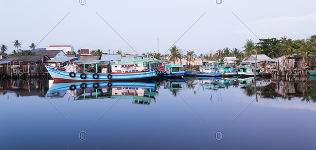 Phu Quoc Island, Vietnam - April 17, 2015: Blue colored fishing boats at dusk in Doung Dong on Phu Quoc Island in Vietnam