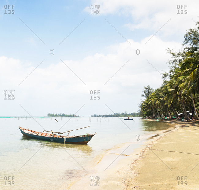 Fishing boats moored along beach on Phu Quoc Island in Vietnam