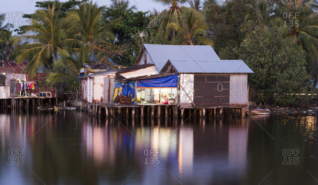 Phu Quoc Island, Vietnam - April 17, 2015: Home with a tin roof in at dusk on the Duong Dong River