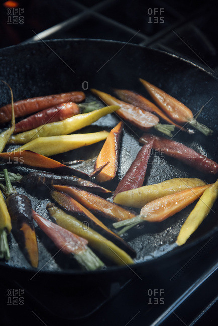 Carrots cooking in a cast iron pan