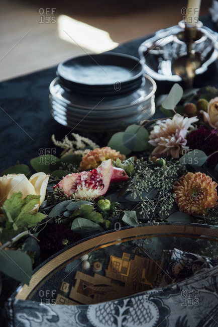 Floral arrangement and pomegranate on a table