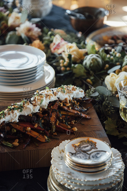 Food laid out on decorated buffet table
