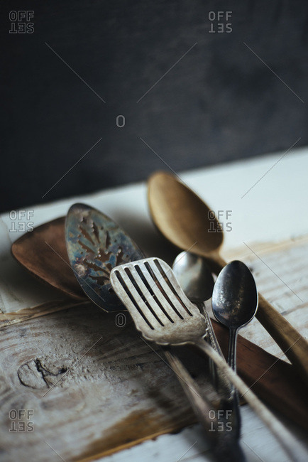 Collection of metal and wooden kitchen utensils