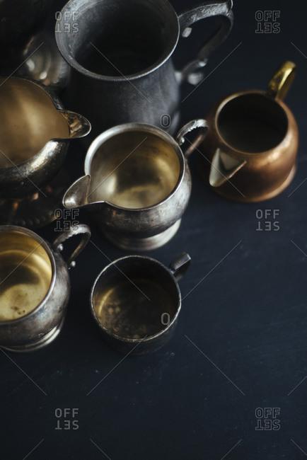 Still life of metal pitchers