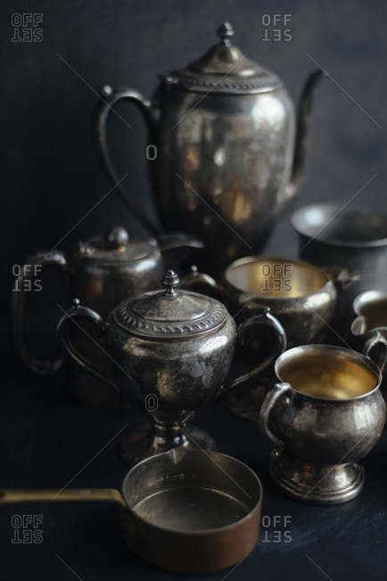 Silver and copper pitchers, urns and pots