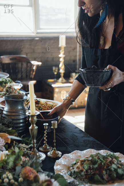 Woman setting food on a buffet table