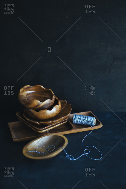 Assorted wooden bowls and string