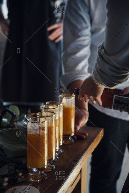 Pouring cocktails at a party