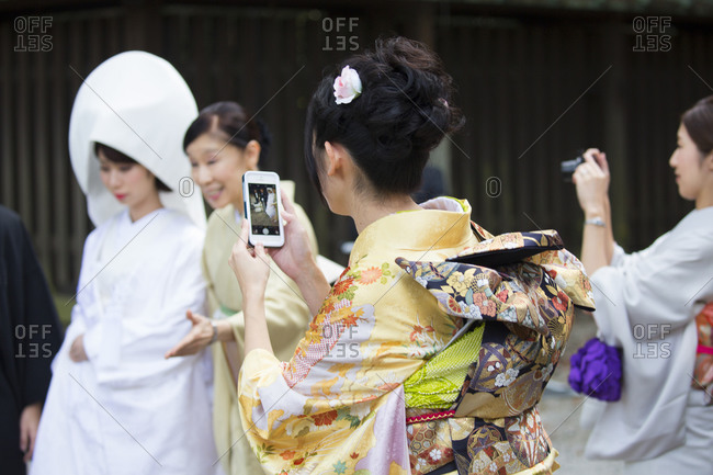 Tokyo, Japan - November 20, 2015: Photographing a bride at Meiji Shrine
