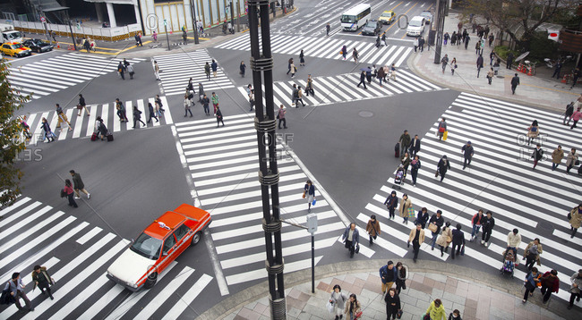 Tokyo, Japan - November 22, 2015: Busy crosswalks in the Ginza district
