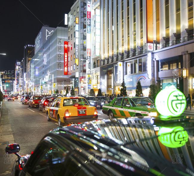 Tokyo, Japan - November 21, 2015: Traffic in Ginza shopping area at night
