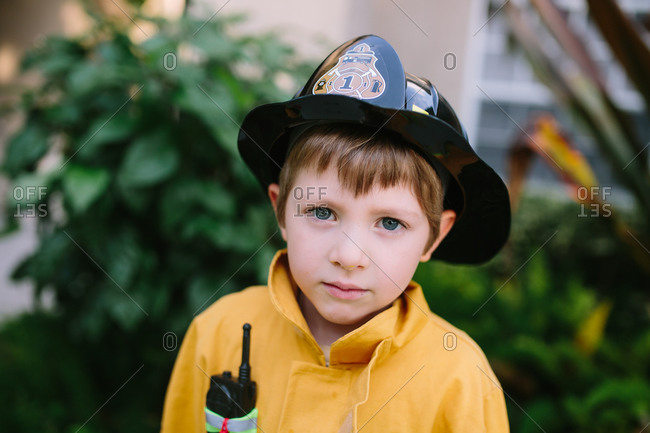Portrait of young boy in fireman costume