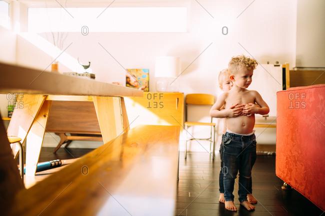 Girl hugging boy in dining room