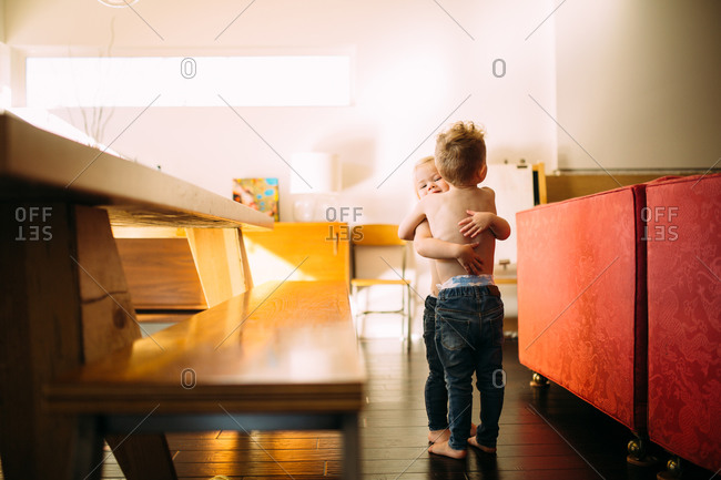 Kids hugging in dining room