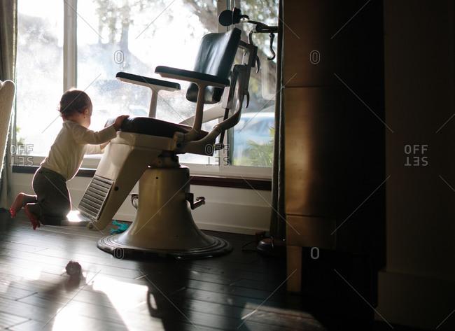 Child climbing dentist's chair