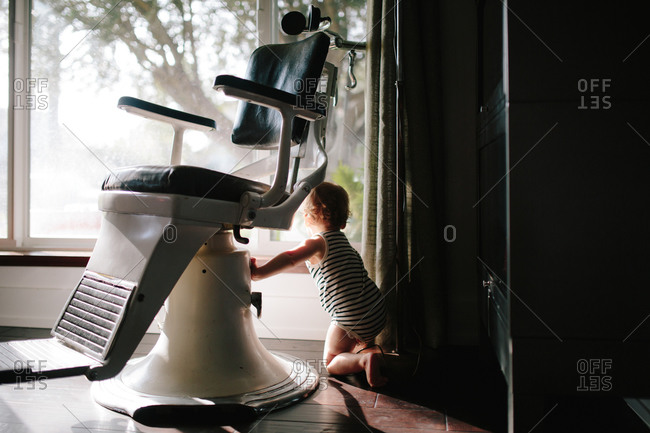 Toddler at window by dentist's chair