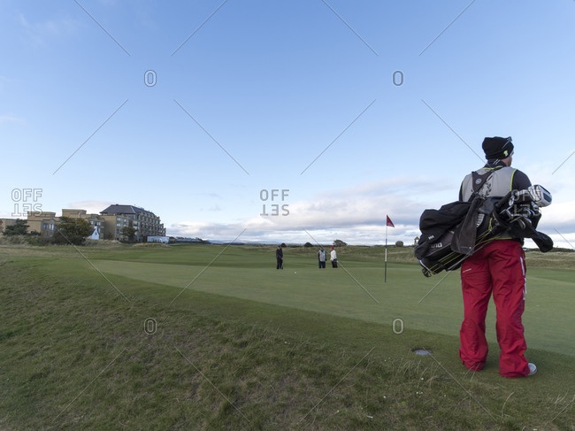 People playing on golf course, Scotland