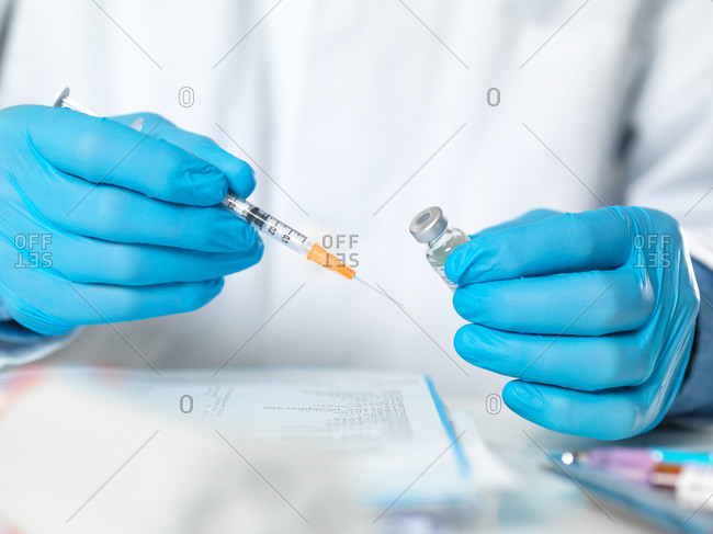 Health worker preparing a vaccine for a patient