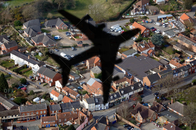 Shadow of an aero plane flying over houses