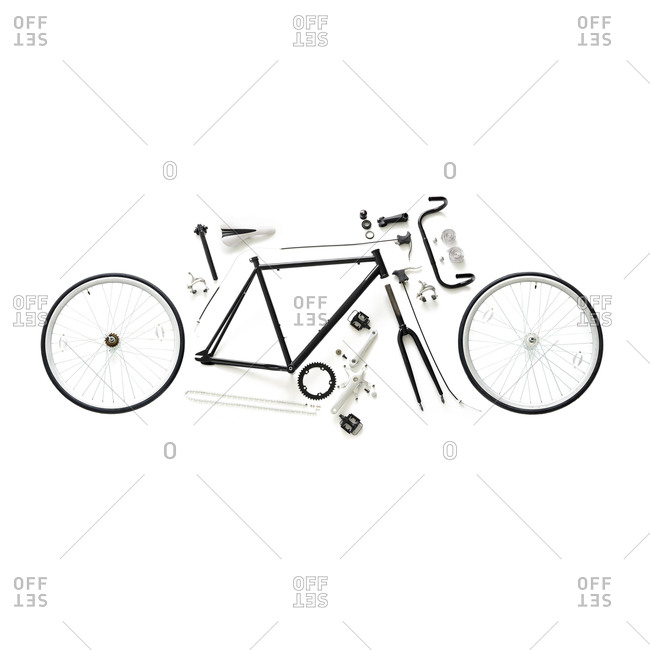 Components of a fixed-gear road bike against a white background