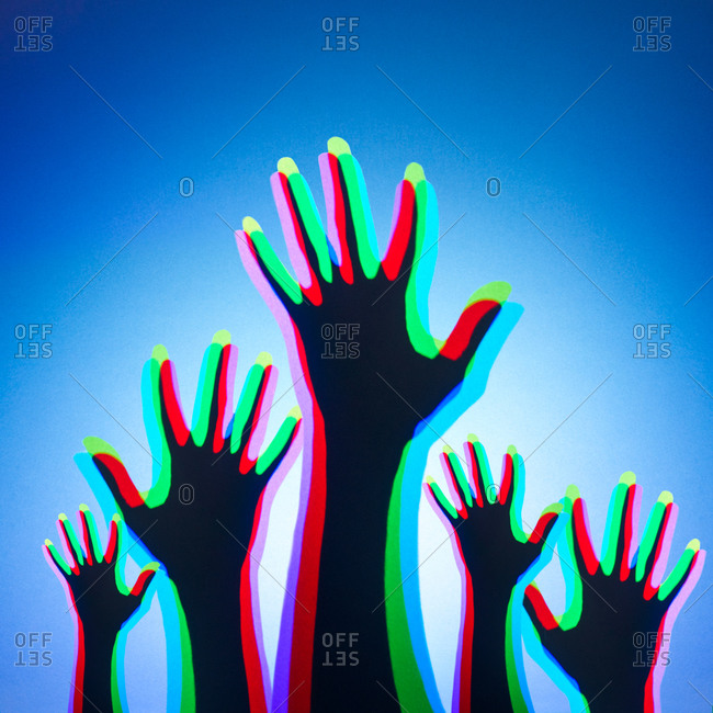 Lights shining onto people's hands and mixing