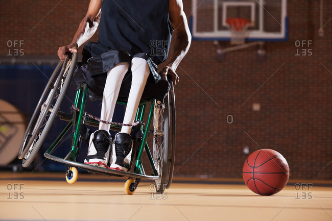 Man who had Spinal Meningitis in wheelchair playing basketball