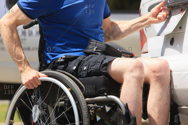 Man with spinal cord injury accessing the back of his car