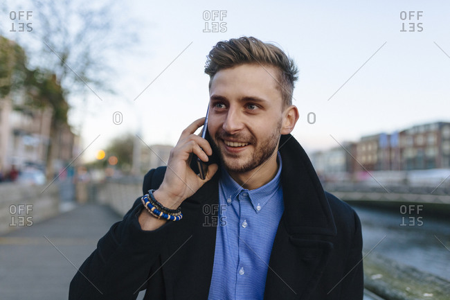 Portrait of young businessman on the phone
