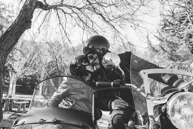 Couple kissing on sidecar motorbike