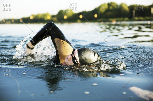 Man swimming in lake