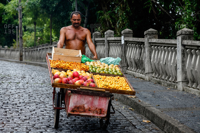 Olinda, Pernambuco, Brazil - March 20, 2010: Man with a fruit cart, Olinda, Pernambuco, Brazil