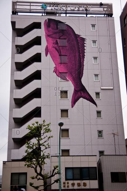 Tsukiji, Tokyo - May 5, 2011: Purple fish on the side of the Tokyu Stay Higashi Ginza