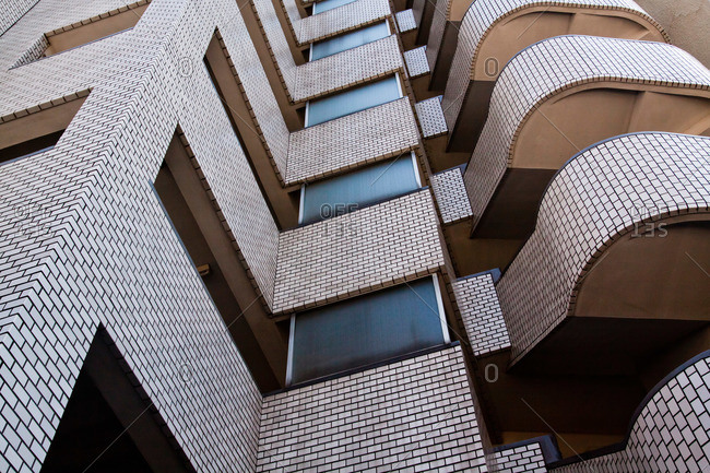 Looking up at an apartment building exterior in Meguro, Tokyo