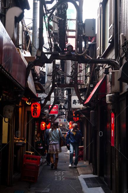 Shinjuku, Tokyo - April 20, 2011: People walking in an alley in Shinjuku, Tokyo