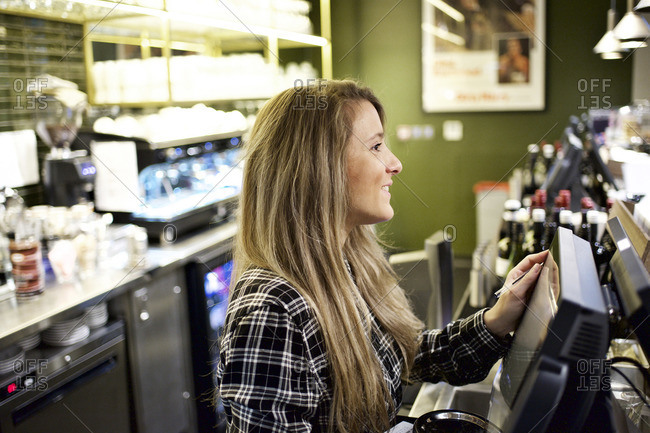 Concession stand worker smiling at register