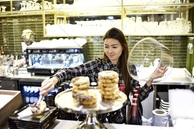 Woman serving pastry at theater concession stand
