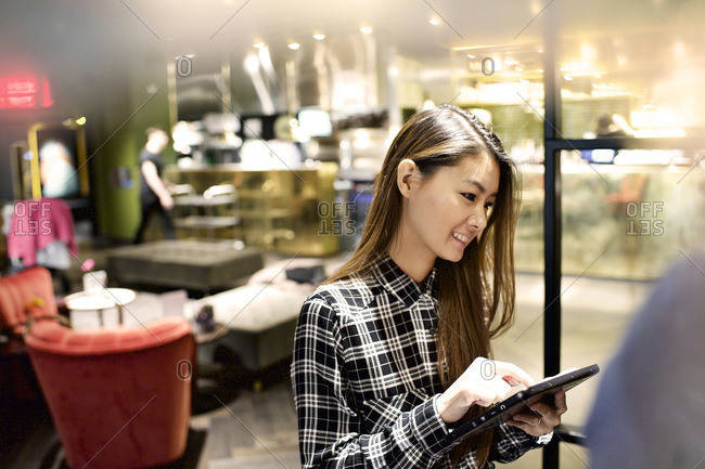 Cafe waitress taking order on tablet