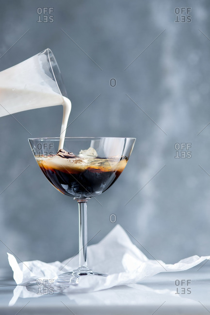 Pouring cream into White Russian