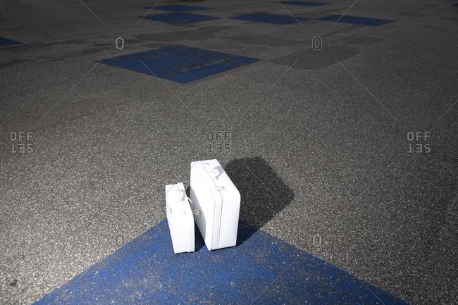 White luggage set on pavement