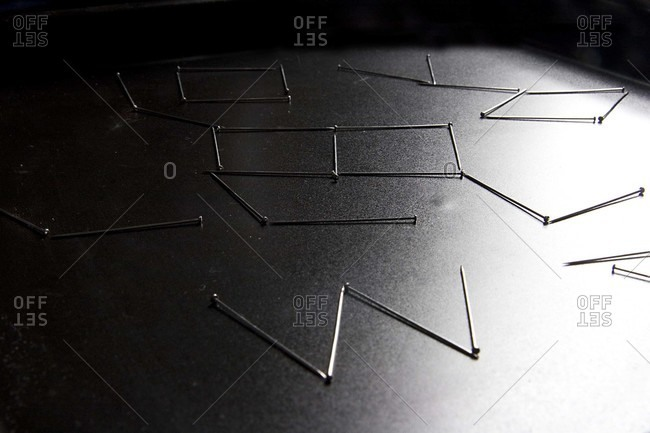 Steel pins arranged in patterns